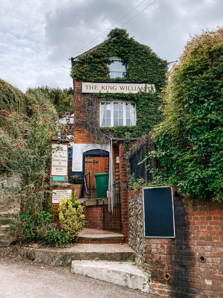 The ivy covered brick frontage of King William pub in Mickelham on the Box Hill Hike
