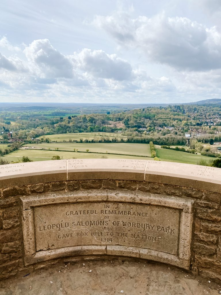 The lookout at Box Hill in Surrey with the Solomon memorial plaque in the foreground and the South Downs in the distance