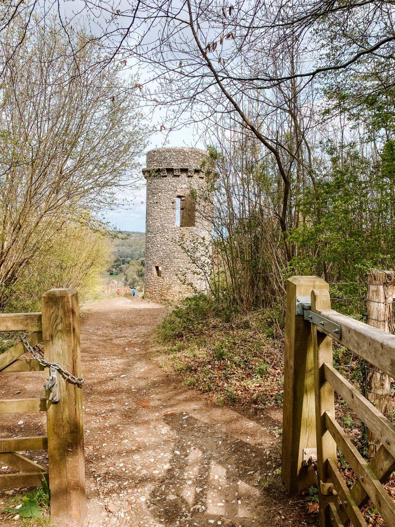 Broadwood's Folly tower seen through an open gate